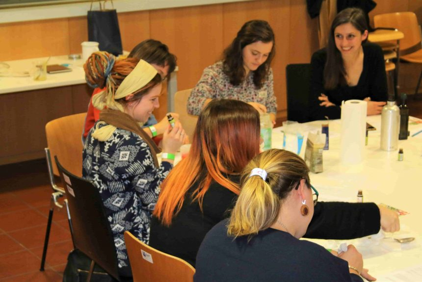 Women at DIY green cosmetics workshop in Vienna working and smiling