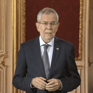 Austrian president Alexander Van der Bellen standing in president office for video message